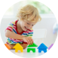 Preschool aged boy playing with colourful blocks