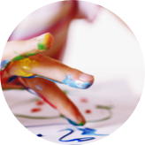 Close up of a hand finger painting