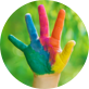 A child's hand covered in colourful paint